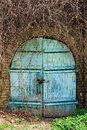 Old wooden door in the wall brick Royalty Free Stock Photography