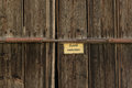 Old wooden door with warning sign Royalty Free Stock Photo