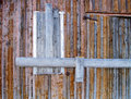 Old wooden doors detail of ageing grey forbackground Royalty Free Stock Photo