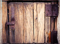 Old wooden drawer door with rusty hinges. Ancient grungy detail Royalty Free Stock Photo