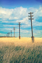 Old wooden electric pillar in the field with retro effect a Royalty Free Stock Images