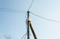 Old wooden electric pole against the sky Royalty Free Stock Photo