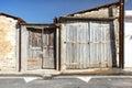 Old wooden facade doors in cypriot village Omodos. Royalty Free Stock Photo