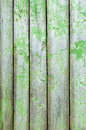 Old wooden fence with cracked green paint Royalty Free Stock Photo