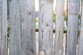 Old wooden fence in the village near house Royalty Free Stock Photo