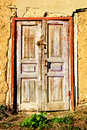 The old,wooden front door with a padlock Royalty Free Stock Photo