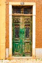 Old, wooden, green door in Portugal Royalty Free Stock Photo