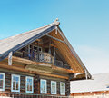 Old wooden house on a background of blue sky Royalty Free Stock Images