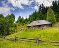 Old wooden house and mountains Royalty Free Stock Photos