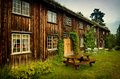 Old wooden house norwegian traditional covered with grass roof Royalty Free Stock Image