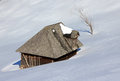 Old wooden house during winter time Royalty Free Stock Photography
