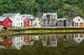 Old wooden houses with reflection at the pond, foot of the mountain in Laerdal, Norway Royalty Free Stock Photo