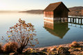 Old wooden hut lake Stock Images
