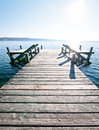 Old wooden jetty lake Stock Images