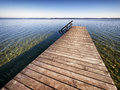 Old wooden jetty at a lake Royalty Free Stock Images