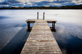 Old wooden jetty at a lake Stock Photos