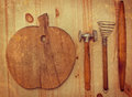 Old wooden kitchen utensils on a grungy background Stock Images