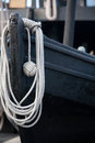 Old wooden lifeboat the bow of an with the rope ready to go Stock Image