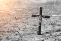Old wooden Orthodox cross in cracked dry earth. Religion - Christianity. Royalty Free Stock Photo