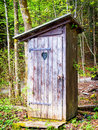 Old wooden outhouse at a forest Stock Image