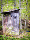 Old wooden outhouse at a forest Royalty Free Stock Image