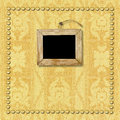Old wooden picture frame hanging on the wall. Royalty Free Stock Photography