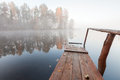 Old wooden pier in cold foggy morning Royalty Free Stock Photography
