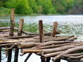 Old wooden pier over river Royalty Free Stock Image