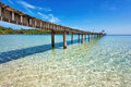 Old wooden pier in the sea Stock Image