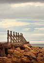Old wooden quay on a beach at lossiemouth in scotland uk Royalty Free Stock Photography