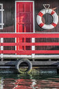 Old wooden red painted raft hut on sava river detail photograph represents of an handmade white placed among many side by side Stock Photography