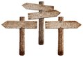 Old wooden road signs right, left and both arrows Royalty Free Stock Photo