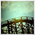 Old wooden rollercoaster in silhouette with vintage treatment Stock Images