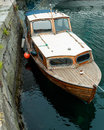 Old wooden row boat on water in Norway Royalty Free Stock Photo