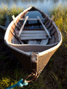 Old wooden rowing boat half full of water Royalty Free Stock Photo