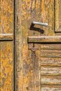 Old wooden rustic door gate texture with large iron handle Royalty Free Stock Photo