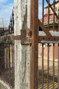 Old wooden and rusty metal fence surrounding an flour mill Stock Photo