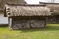 Old wooden shed with a straw roof Royalty Free Stock Image
