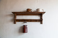 Old wooden shelf with milk jug Royalty Free Stock Photos
