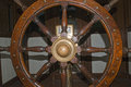 Old wooden ship wheel detail Stock Image