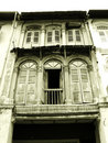 Old wooden shophouse windows Stock Photo