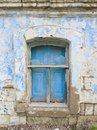 Old wooden shutters on windows with broken panes Royalty Free Stock Photo