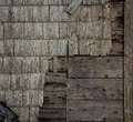 Old wooden siding decaying and peeling on a house Stock Images