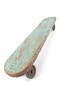 Old wooden skateboard on white Stock Photos