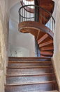 Old wooden spiral staircase - Chindia Tower - landmark attraction in Targoviste, Romania Royalty Free Stock Photo