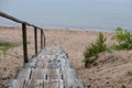 Old wooden stairs leading to the beach from the sand dunes Royalty Free Stock Photo