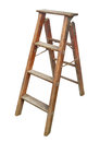 Old wooden stepladder isolated and worn small on white Royalty Free Stock Image