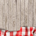 Old wooden table background with picnic tablecloth red Royalty Free Stock Photo