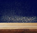 old wooden table in front of glitter lights background Royalty Free Stock Photo