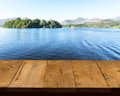 Old wooden table or walkway by lake Royalty Free Stock Photos